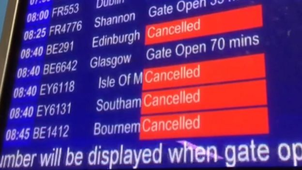 Departure board at Manchester airport showing cancellations