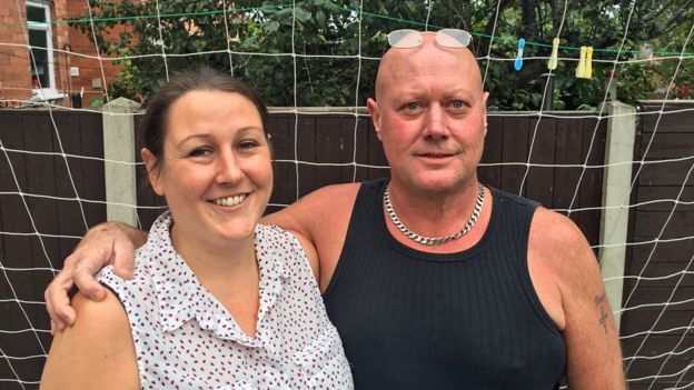 Andy and Tracey in their garden