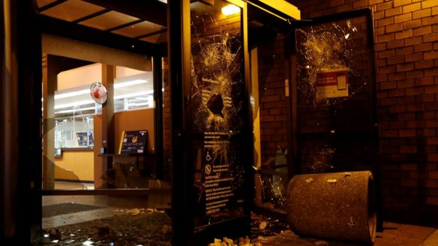 A vandalised Bank of America office in Berkeley, Calfornia, after protests against Milo Yiannopoulos's university talk got out of hand