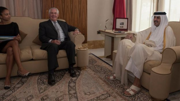 US Secretary of State Rex Tillerson (C) meets Qatar's Emir, Sheikh Tamim Bin Hamad Al Thani (R), at the Sea Palace in Doha, Qatar (13 July 2017)