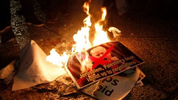 Palestinian demonstrators burn pictures with US President Donald Trump in Bethlehem, West Bank. Photo: 6 December 2017