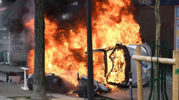 Vehicles are burning as thousands of people take to the streets during the May Day demonstrations on 1 May 2018 in Paris, France.