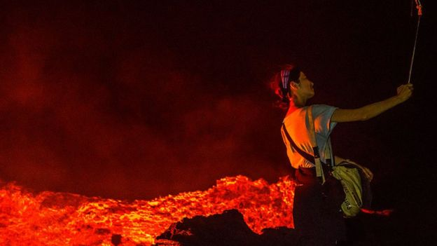 Woman near burning lava