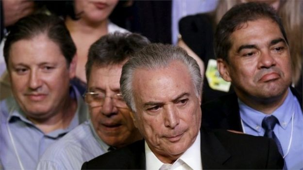 Brazil's Vice President Michel Temer (C) looks on during the Brazilian Democratic Movement Party (PMDB) national convention in Brasilia, Brazil, March 12, 2016