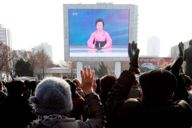 North Koreans watch a news broadcast about the test on a video screen outside Pyongyang Railway Station