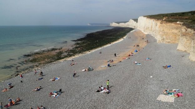 People on the beach at Birling Gap