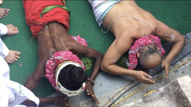 Mr Rangaran and Aditya praying together inside the temple.