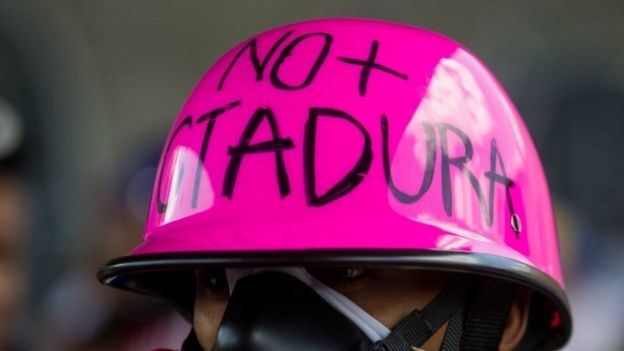 A man with a message in his helmet that reads