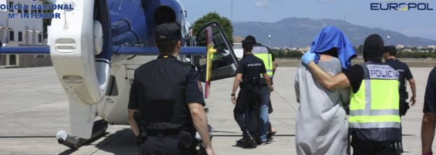 A suspected jihadist is transferred to police custody at Palma de Majorca
