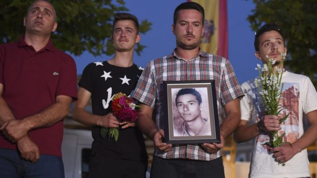 Kosovo Albanians hold portrait of Diamant Zabergja in Pristina city square to pay respect to the victims of shooting spree in Munich. 24 July 2016