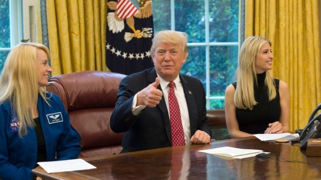 Donald Trump speaks along with his daughter Ivanka Trump (R) and NASA Astronaut Kate Rubins, during a video conference with NASA astronauts aboard the International Space Station in the Oval Office at the White House April 24, 2017 in Washington, DC