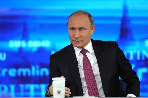 Russian President Vladimir Putin answers questions in Moscow, 15 June