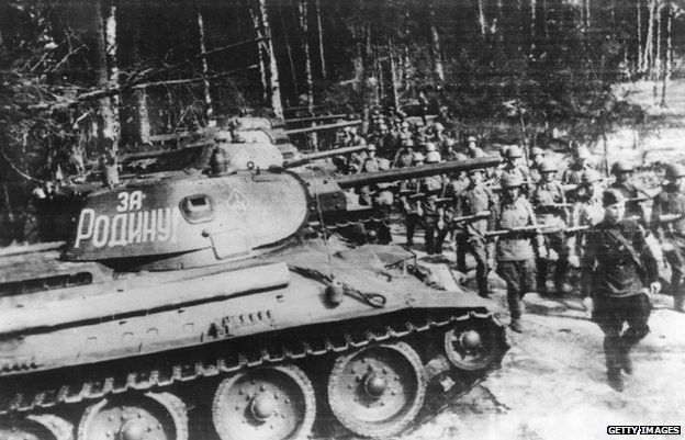 Russian soldiers march past the T-34 tank in 1943