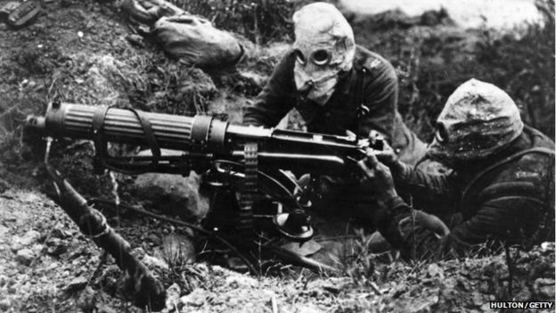 Machine gunners at the Battle of the Somme in 1916 wearing a later form of gas mask
