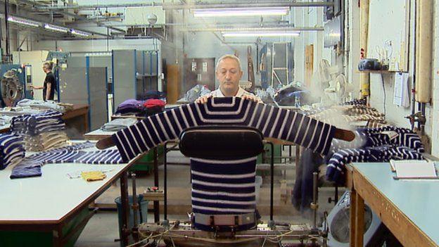 Knitwear being steamed