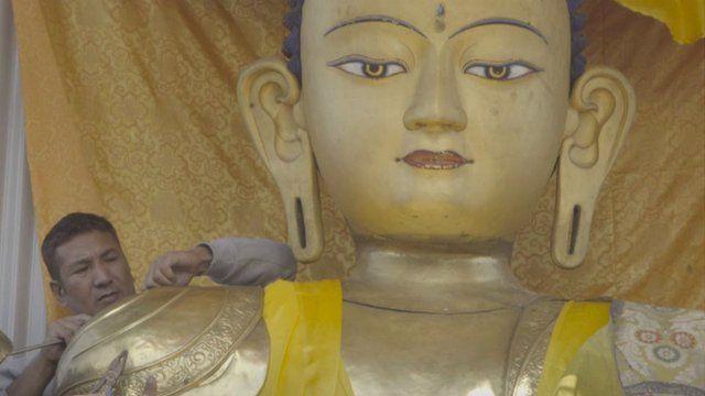 Metalworker Binod Sakya works at Swayambhunath temple, Kathmandu, Nepal