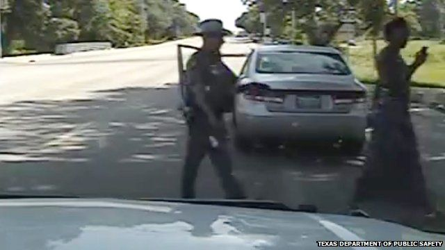 Still from dashcam footage showing a Texas trooper allegedly pointing a stun gun at Sandra Bland during a traffic stop