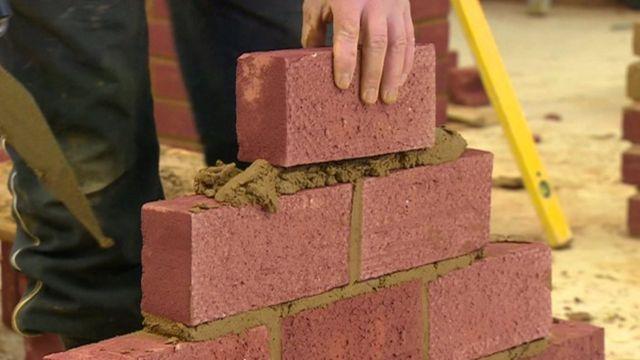 Brick wall being built