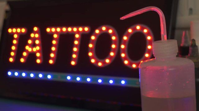"""Neon sign with word; """"Tattoo"""""""