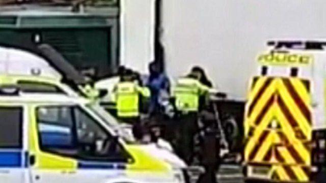 Police arresting migrants