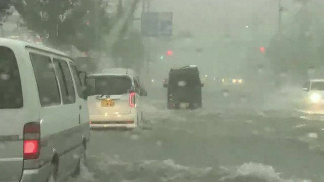Roads flooded by Typhoon Goni