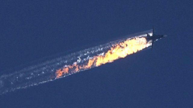 Smoke billows from the crash site on the Turkey-Syria border
