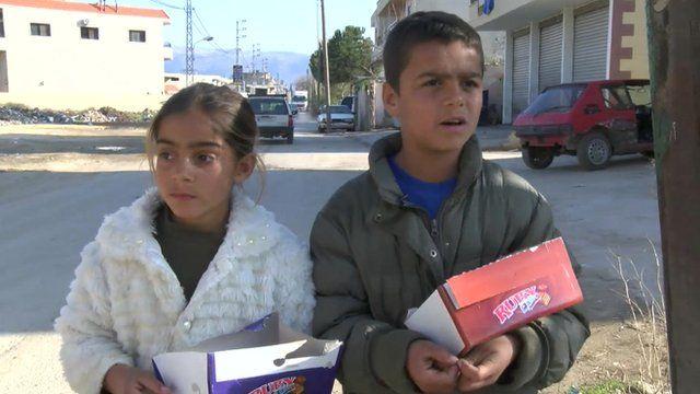 Batoul and Mohamed selling chocolate.