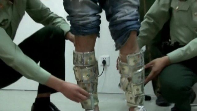 Money taped to man's legs