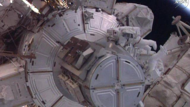 Astronauts on spacewalk
