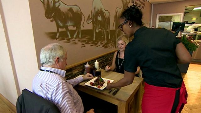 waitress serves couple