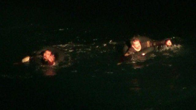 Migrants in sea calling for help
