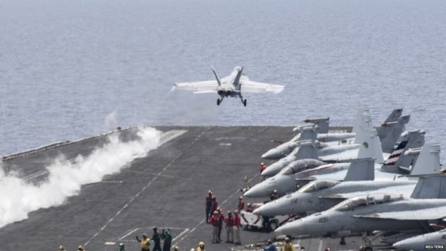 Fighter jet launches from the flight deck of the aircraft carrier USS Harry S Truman in the Mediterranean