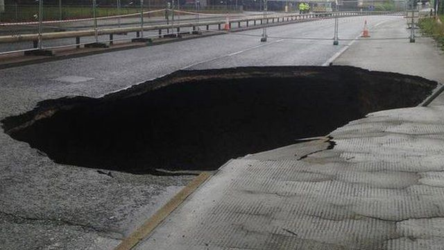A large sinkhole which appeared in Mancunian Way in Manchester