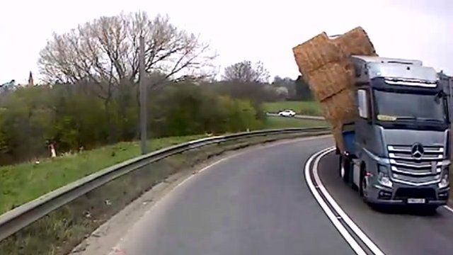 Hay bales toppling off the lorry