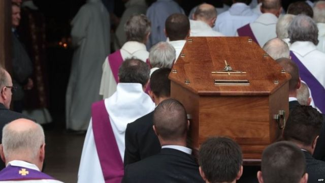 Pallbearers carry the coffin of Father Jacques Hamel