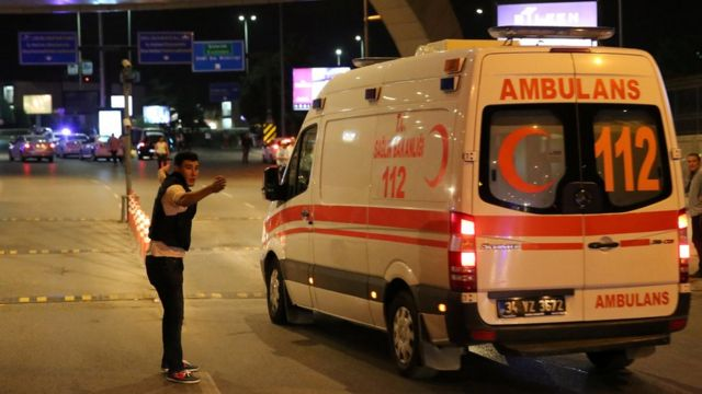 A policeman gestures in front of an ambulance at Istanbul Ataturk airport, Turkey, following a blast 28 June 2016.