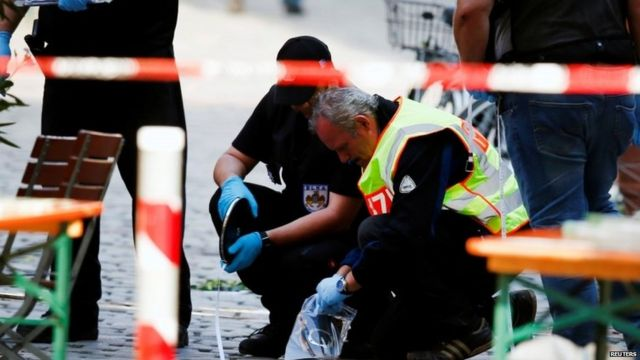 Police secure the area after an explosion in Ansbach, Germany
