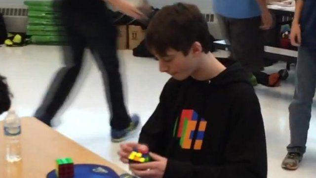 Boy smashes Rubik's cube record.