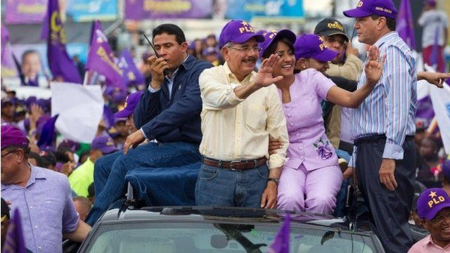 Danilo Medina (c) and supporters