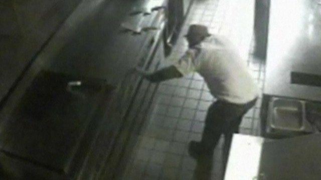 CCTV of man cooking burgers