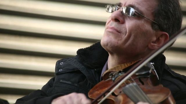 Syrian man plays violin