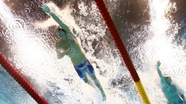 Michael Phelps in the 100 metre relay