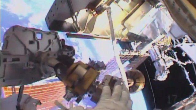 The view from Tim Kopra's helmet camera of him setting up equipment.