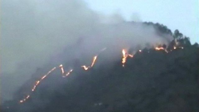 fire snakes across hillside