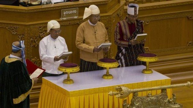 Htin Kyaw (centre) was sworn in as president along with his vice-presidents