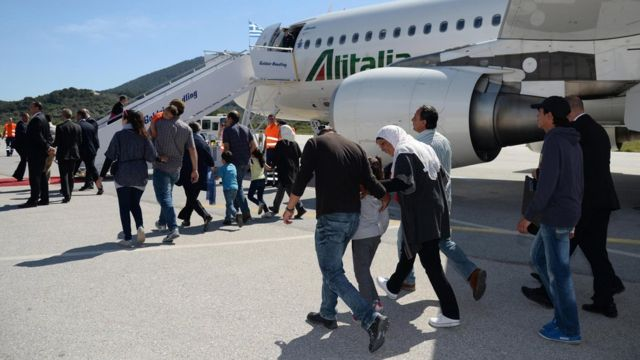 The migrants are travelling on the same plane as the Pope back to the Vatican