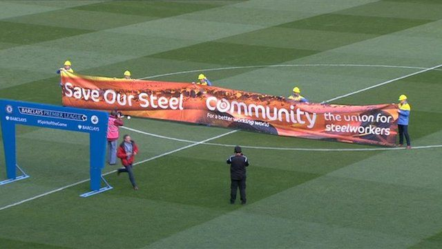 Steelworkers parade their banner at the Swansea City v Chelsea match
