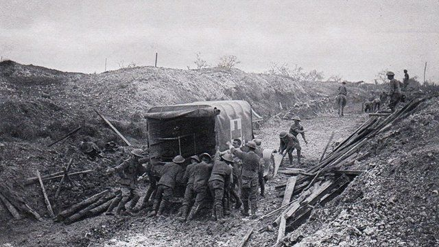 Men push ambulance through mud at Mametz Wood, July 1916