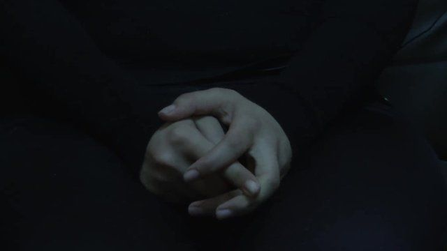 Hands of woman held against her will