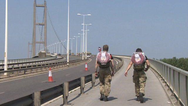 Soldiers walking across Humber Bridge